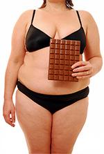 Лишний вес из-за сладостей способствует появлению изжоги